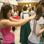 Hayley Watson (9) helps Elizabeth Ward (9) with her costume. Photo by Julia Nguyen.