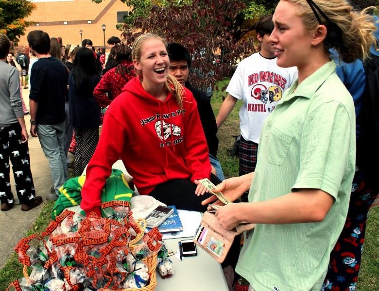 "Students sell ""puppy chow"" to students at carnival. Photo by Mesa Serikali"