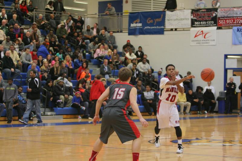 JaKory Freeman (12, #10) makes a quick pass to a teammate to his left.