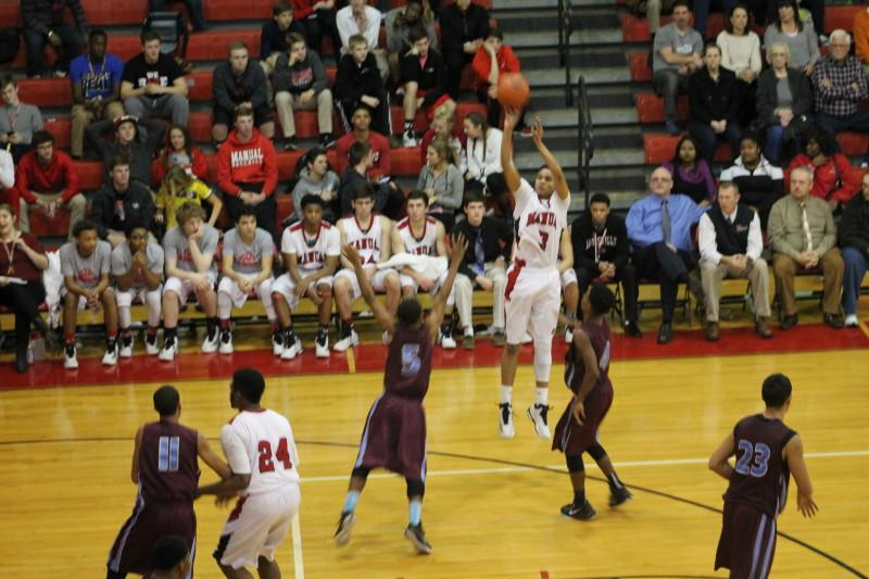 Chris West (12, #3) hits an open three. West had 14 points for the Crimsons, including six in the first quarter.