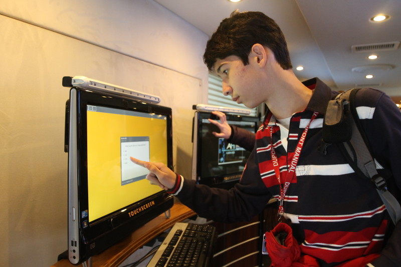 Jacob Keisling (10) takes one of the surveys on the computers inside the bus.
