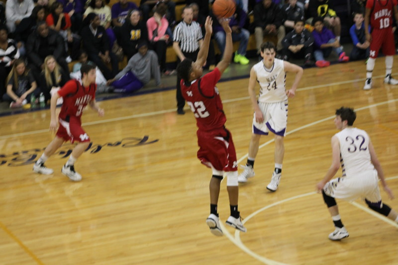 Dwayne Sutton (12, #22) shoots and makes a three. This was one of Manual's only field goals of the second half.