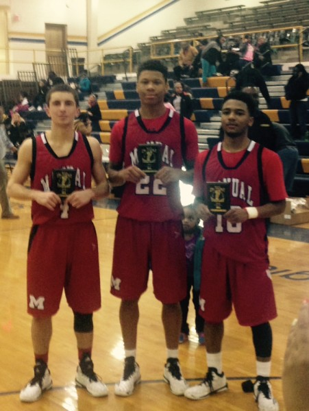 Jarrett Harness (12, #4), Dwayne Sutton (12, #22) and Ja'Kory Freeman (12, #10) all received All-Tournament honors for the District 25 tournament. Photo by, Jack Grossman