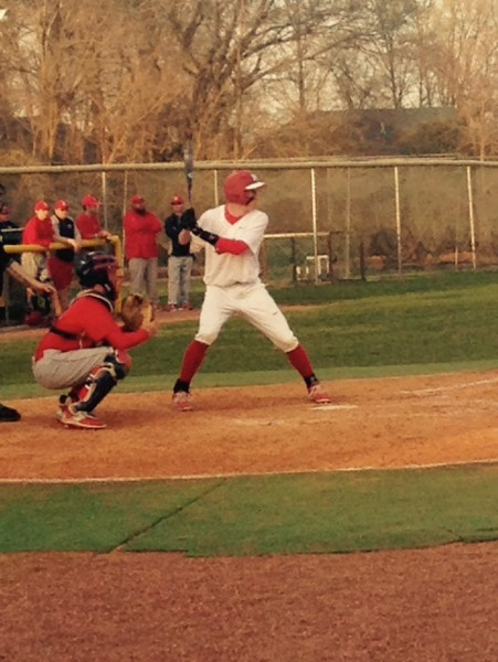 Chris Gambert (11, #25) takes his stance in the batters box. Gambert reached base twice on the day, including a big double in the bottom of the third inning that led to Manual's only run of the ballgame. Photo by Jack Grossman
