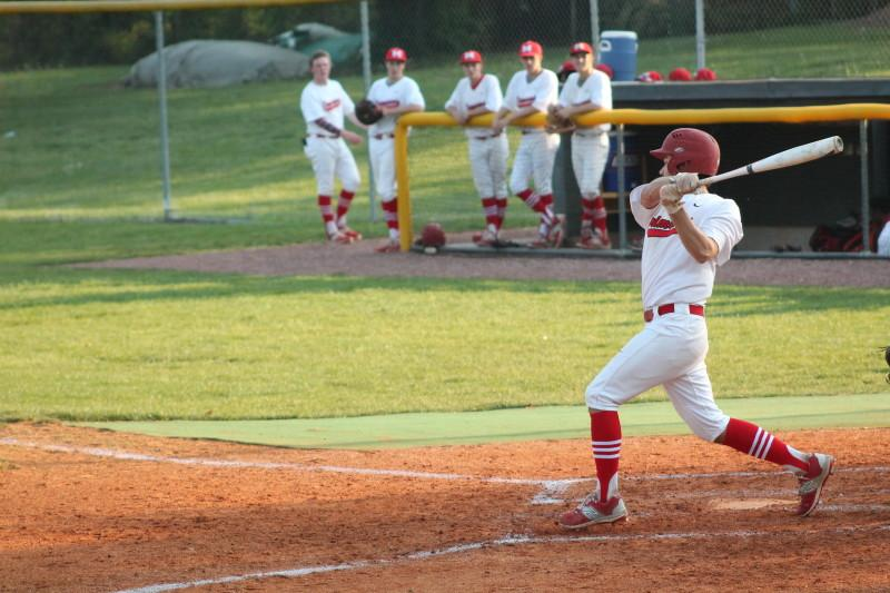 Matthew Marino (12, #7) swings at the ball in the bottom of the second inning. Marino hit a single, allowing teammate Matt Olson (11, #2) to get to third base. Olson would score on the next play off a hit from Aaron Sary (9, #20), Manual's first score of the game.