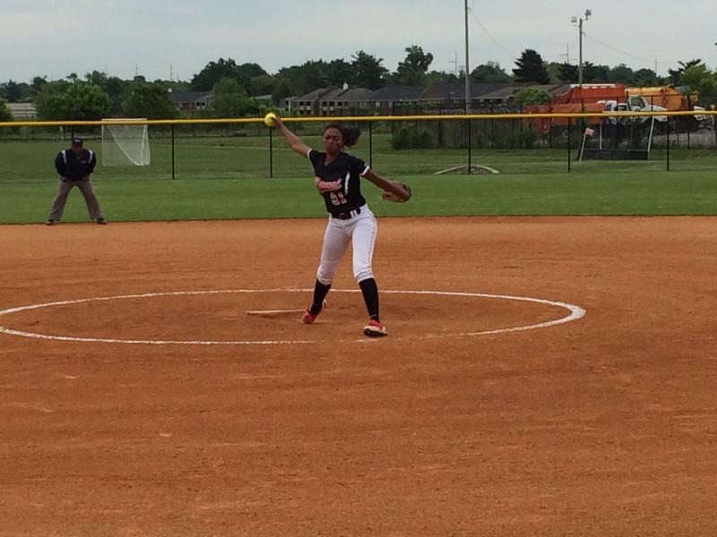 Pitcher Madison Williams (11, #21) winding up for a pitch. Photo by RJ Radcliffe