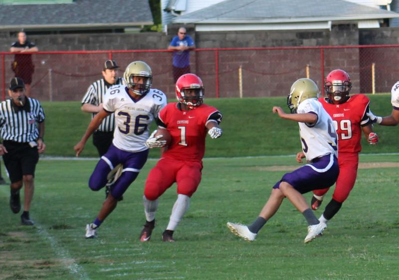 Reece West (12, #1) runs for a 49 yard kickoff return to give Manual good starting field position in the third quarter. Photo by Kate Hatter