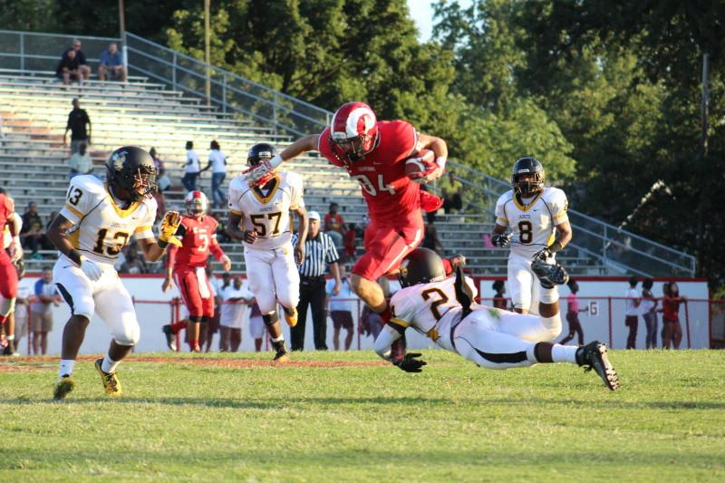 Eric Niemann (12, #84) gets Manual to Central's 39 yard line with a pass from Tim Comstock (12, #3). Photo by Kate Hatter