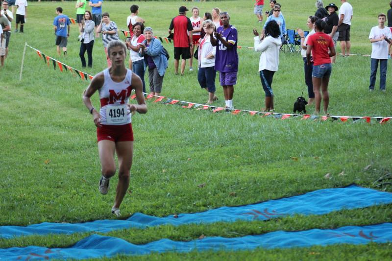 """Alena Spaienza-Wright (10) finishes with a record-breaking time. """"Emma Kuntz (11) had a great race, and we both ran really well. It was really fun actually, once you got going, I kind of got over my nerves. Emma started out really strong,"""" Sapienza-Wright said. Photo by Kate Hatter"""