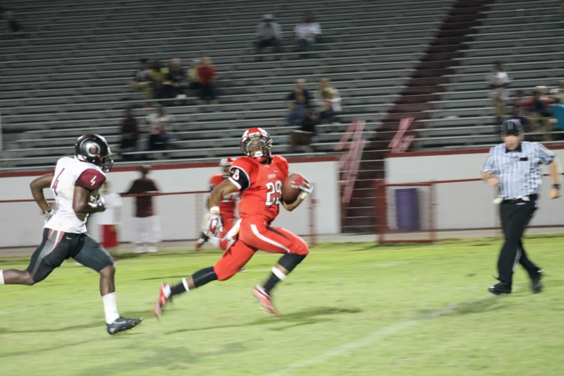 Troy Henderson (10, #29) runs for a 34 yard touchdown to give Manual a 24-19 lead with 2:36 left in the game.