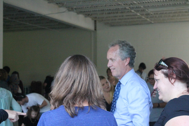 Mayor Fischer interacts with community members. He later tweeted that this event proves that love always wins. Photo by Kaylee Arnett.