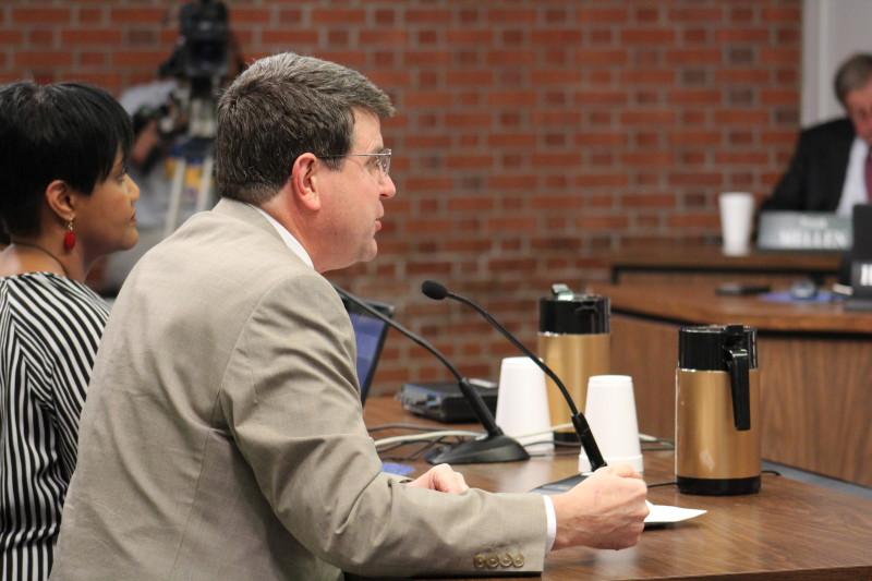 Jefferson County Teachers' Association (JCTA) president Brent McKim presents the 2014-2015 TELL survey results to the board. Photo by Kate Hatter