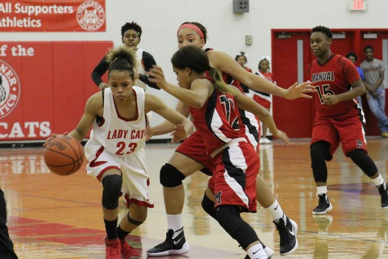 Trapping ball handlers and forcing turnovers were both key to Manual's stifling defense. Photo by Kate Hatter.