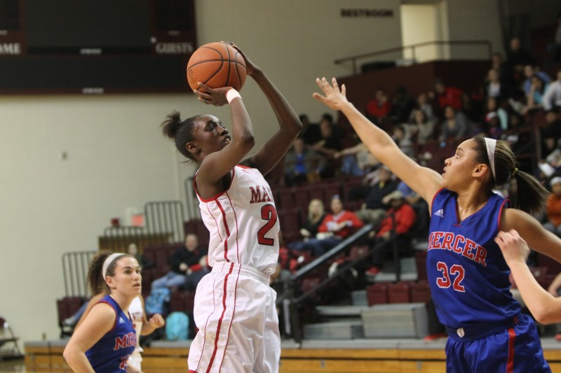 Aniah Griffin (10, #21) rises up from three to send the game to overtime. Photo by Jordyn Stumpf.
