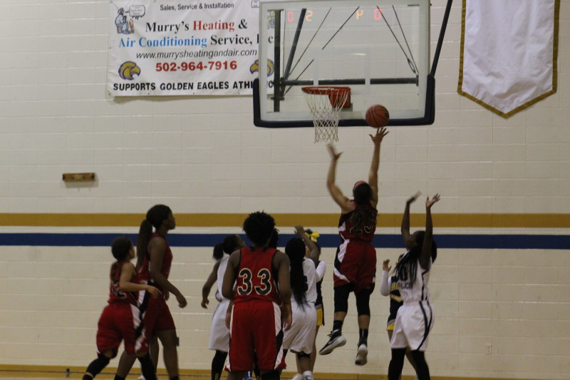 Tonysha Curry (12, #23) goes up for a lay up in the second quarter. Photo by Kate Hatter