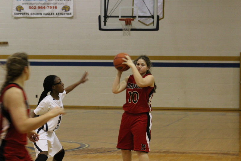 Marlena Groves (12, #10) looks to Grace Tatro (10, #40) to carry out the play. Photo by Kate Hatter