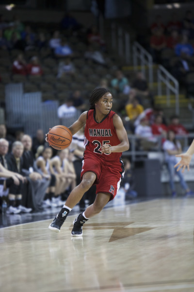 Nyah Smith (9, #25) brings the ball up court. Photo by Piper Cassetto.