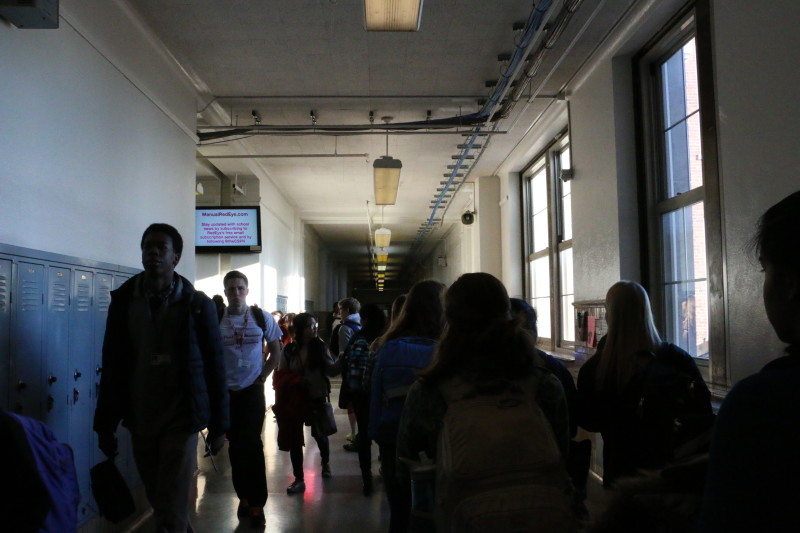 Current Manual students walk the halls as incoming freshmen prepare for next year. Photo by Fons Cervera.