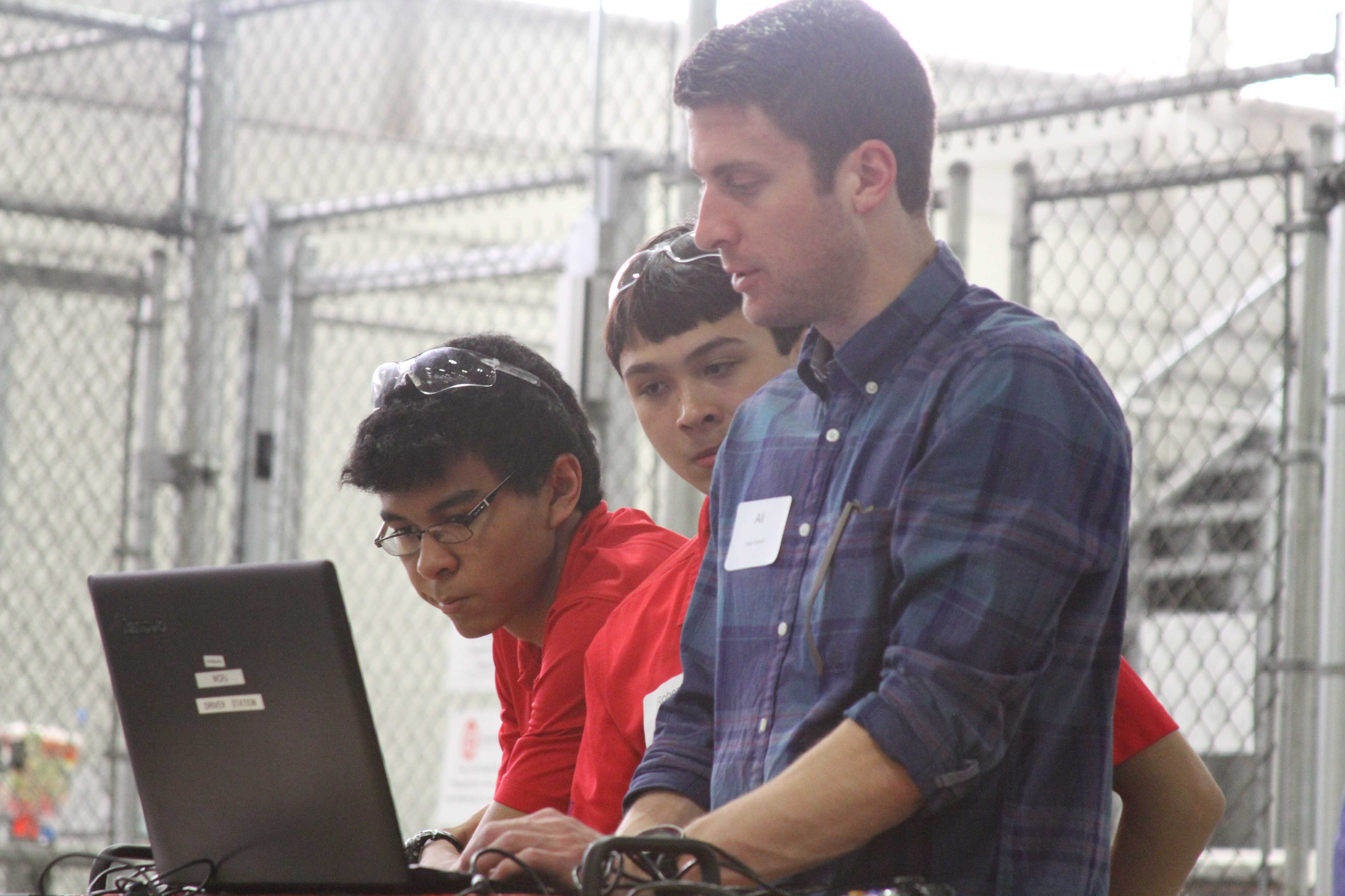 Manual robotics Engineering Captain Roberto Bolli (12, MST) works with a University of Louisville engineering mentor. Photo by Peter Champelli.