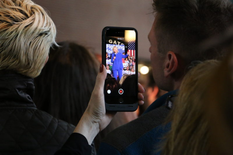 A supporter at the Clinton rally takes video of Clinton. Photo by Fons Cervera.