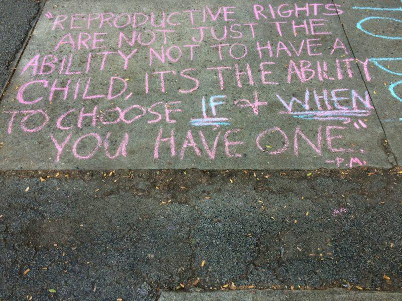 Words in favor of reproductive rights for women written on Manual's courtyard. Photo by Maya Joshi